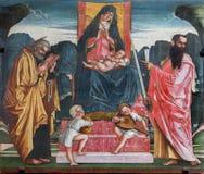 Treviso - Madonna con il bambino e gli apostoli St Peter e Paul a San Nicola o la chiesa di San Nicolo. Immagini Stock