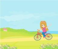 trevlig cykelflicka Royaltyfri Fotografi