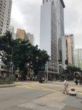 Trevlig dag som är molnig, stad royaltyfria bilder