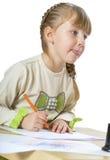 Trevlig liten flicka som leker med Arkivbilder