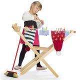 Trevlig liten flicka som leker med Royaltyfri Fotografi