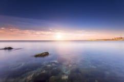 Trevlig ljus solnedgång Arkivfoto