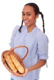 Trevlig multi-ethnic flicka med bröd i korg fotografering för bildbyråer