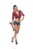Trevlig sexig skiftnyckel för kvinnamekanikerinnehav fotografering för bildbyråer