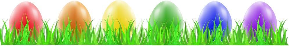 Trevliga easter ägg på det gröna gräset Arkivfoto