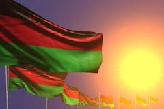 Trevligt förlade många Malawi flaggor diagonalt på solnedgång med utrymme för ditt innehåll - någon illustration för berömflagga  royaltyfri illustrationer