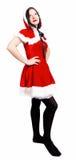 Trevligt posera för flicka som kläs som Santa jul Royaltyfri Bild