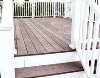 Trex deck floor with steps. And vinyl rails Stock Images