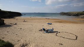 Treyarnon Bay Cornwall England UK Cornish north coast between Newquay and Padstow on a sunny summer blue sky day with people stock video footage