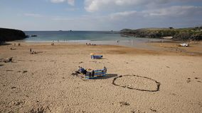 Treyarnon Bay Cornwall England UK Cornish north coast between Newquay and Padstow on a sunny summer blue sky day with people PAN stock footage
