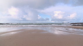 Treyarnon Bay in Cornwall. Static view from the beach at Treyarnon Bay on a cloudy winters day stock footage