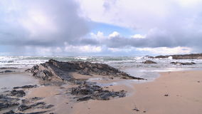 Treyarnon Bay in Cornwall. View at low tide on beautiful Treyarnon Bay beach on a cloudy winters day stock footage