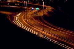 Tráfego em a noite Fotografia de Stock Royalty Free