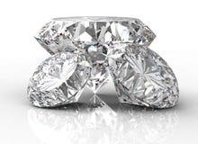 Trhee diamant som isoleras på vit Royaltyfria Bilder