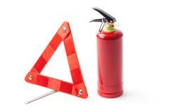Triángulo del camino de la emergencia y extintor Fotos de archivo