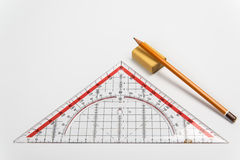Triángulo simple del lápiz, del borrador y de la regla Foto de archivo libre de regalías