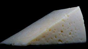 Triángulo texturizado del queso Foto de archivo