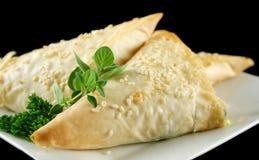 Triángulos del queso Feta y de la espinaca Foto de archivo