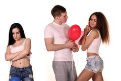 Triângulo amoroso Homem e duas mulheres imagem de stock royalty free