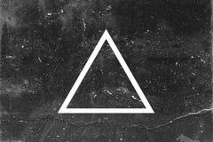 Triângulo branco no fundo escuro Imagens de Stock Royalty Free