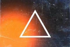 Triângulo branco no fundo escuro Foto de Stock