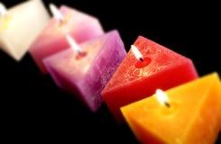 Triângulo brilhante dado forma velas Imagens de Stock