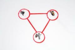 Triângulo equilateral dos homens de negócios Fotos de Stock