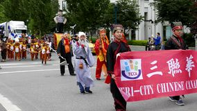 Tri-city Chinese Canadian association parading the street stock video