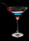 Tri-color cocktail martini with a cherry Royalty Free Stock Images