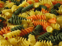 Tri-Color Pasta. Close-up of curly, multicolored pasta royalty free stock photo