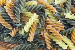 Tri-Color unprepared pasta stacked to form background Royalty Free Stock Photography