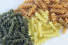 Tri-Color unprepared pasta stacked to form background Royalty Free Stock Photos