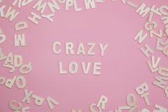 Tri de l'amour fol de lettres sur le rose Photographie stock