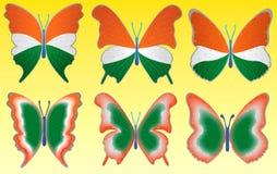 Tri mariposa del color en fondo amarillo Fotografía de archivo