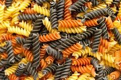 Tri mucchio colorato della pasta Fotografie Stock