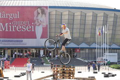 Trial biker jumping. A trial biker jumping at the Iubim 2 roti (We love two wheels) event in Romania, at Romexpo. At this event it was seen a show made of Free Stock Image