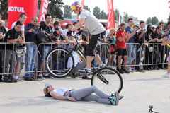 Trial biker jumping over woman. A trial biker jumping over a woman at the Iubim 2 roti (We love two wheels) event in Romania, at Romexpo. At this event it was Stock Photography