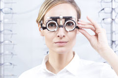 Trial frame for lens determination. Young woman with trial frame for lens determination Royalty Free Stock Image