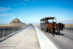 Trial horse car leave from background historic site Mont saint michel on 23 March 2016. Great trial horse car leave from background historic site Mont saint stock image