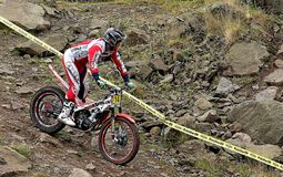 Trial motorcycle rider on rocky slope Royalty Free Stock Photos