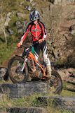 Trial motorcyclist standing on bike Royalty Free Stock Photography