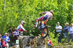 Trial Spain Championship. EL Condao, SPAIN - MAY 10: Trial Spain Championship on May 10, 2015 in El Condao, Spain. Moment when Toni Bou jump over granite rocks Royalty Free Stock Image