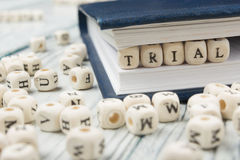 TRIAL word written on wood block. Wooden ABC Stock Image