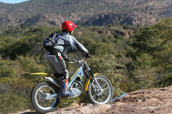 Trials bike rider. In the desert stock image