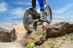 Trials motorcycle is jumping over rocks. Trials motorcycle is practice jumping over rocks Stock Photo