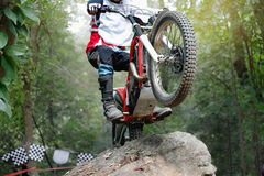 Trials motorcycle is jumping over rocks. Trials motorcycle is practice jumping over rocks before race royalty free stock photo