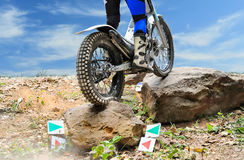Trials motorcycle is jumping over rocks. Trials motorcycle is practice jumping over rocks before race stock photo