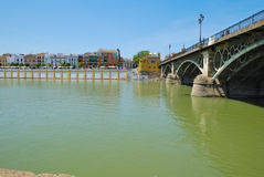 Triana. Bridge in Seville (Andalusia, Spain), connects the downtown with the  district across the river Guadalquivir royalty free stock photography