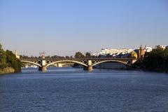 Triana Brücke in Sevilla Stockfotos