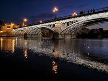 Triana bridge Bridge of Isabel II over the river Guadalquivir, Sevilla, Andalucia, Spai. N royalty free stock photos